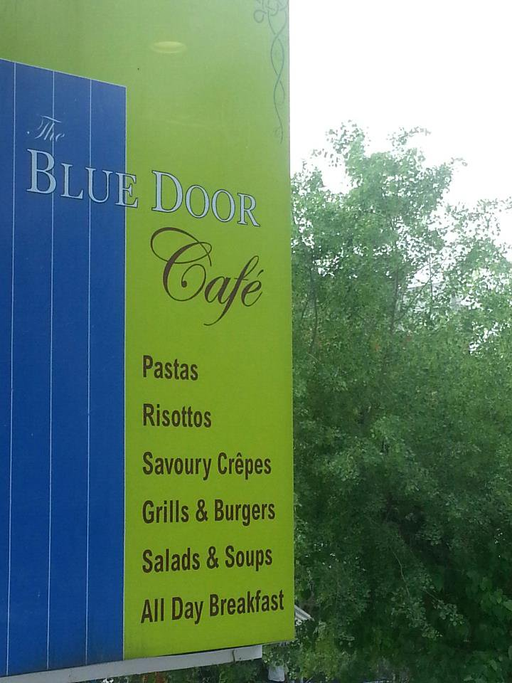 Blue Door Cafe Khan Market sign